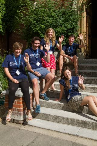 住宅 Activity Organisers at Sir Christopher residential English summer camp wave on steps of 里德利学院大厅